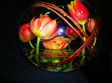 tulips and painted rose wrapped inside glass bowl