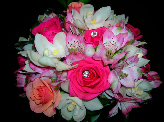 bejwelled pink roses, coral roses with alstramaria and white orchids